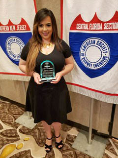 Laura Campos, EI accepts the ASHE National Young Member of the Year award