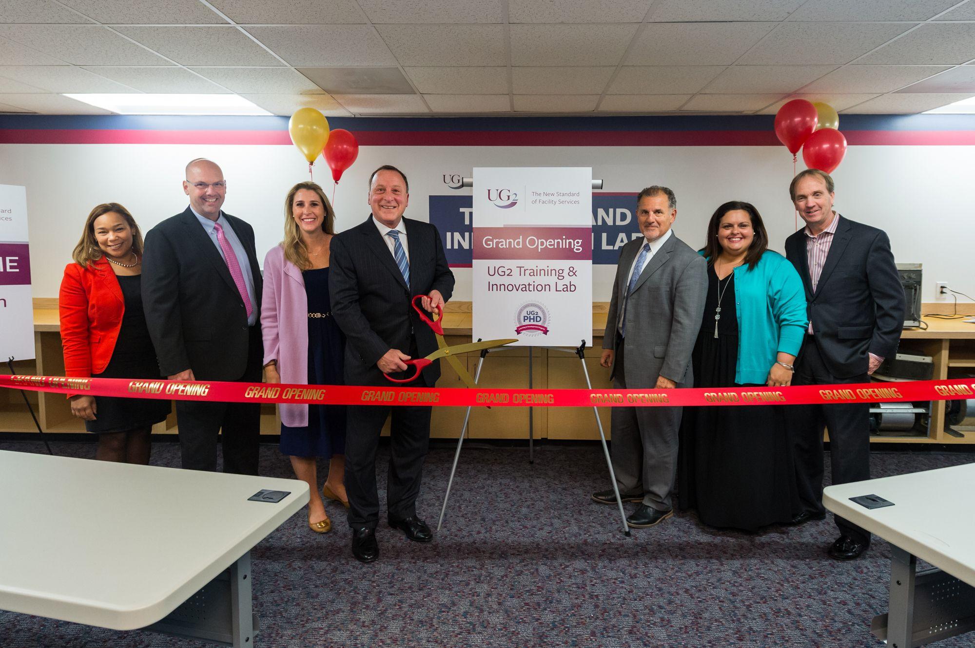 UG2 Senior Leadership cuts the ribbon at its new Innovation & Training Lab