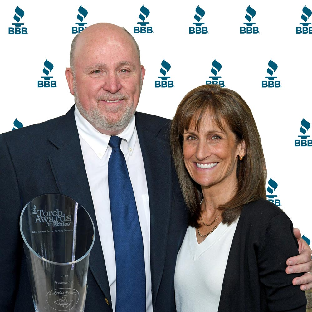 Morty Bachar and Patty Storms receiving the BBB Torch Award, DuPont Country Club