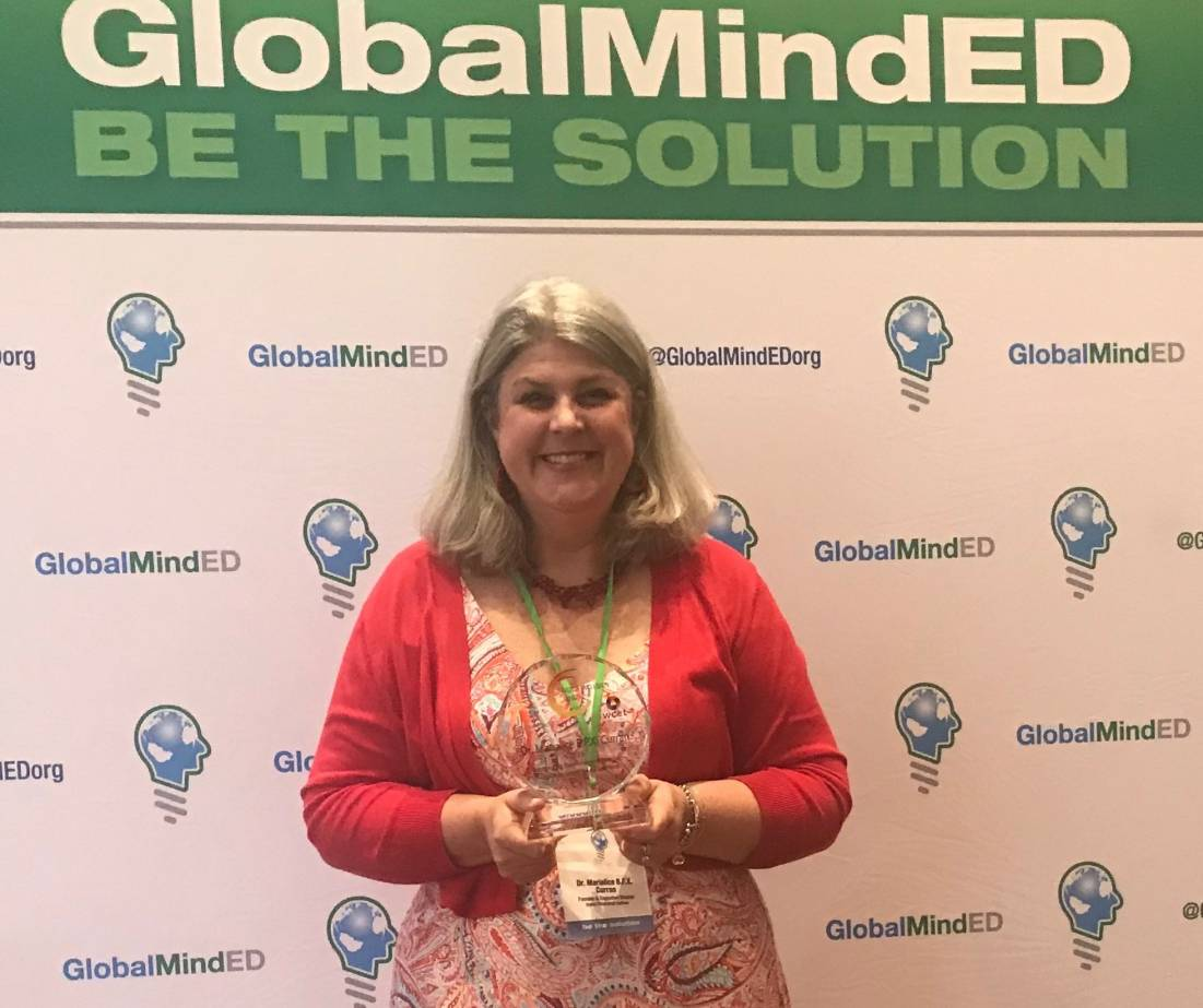 Dr. Marialice B.F.X. Curran accepting Digital Inclusion Award at GlobalMindED