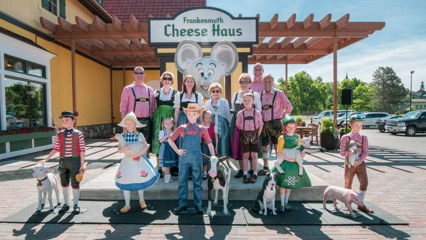 The Frankenmuth Cheese Haus characters with family