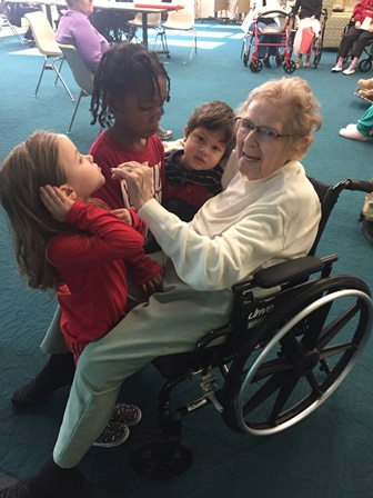 Trinity Oaks residents and their young guests enjoy spending time together.