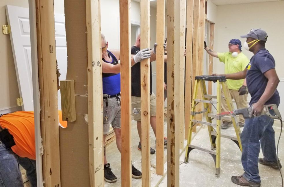 Overhead Door volunteers at the future location of The Drake Closet on June 8.