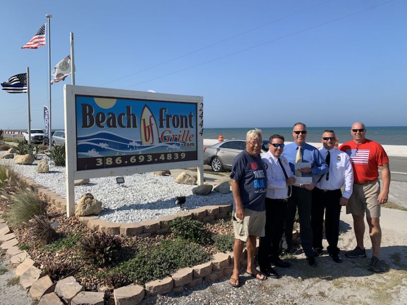 Flagler Beach Police & Flagler County Fire Dept. receive donations.