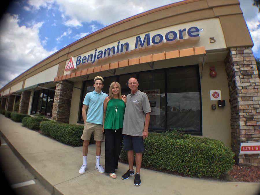 Ethan, Karla and Allen Goodman in front of the new Benjamin Moore Paints.