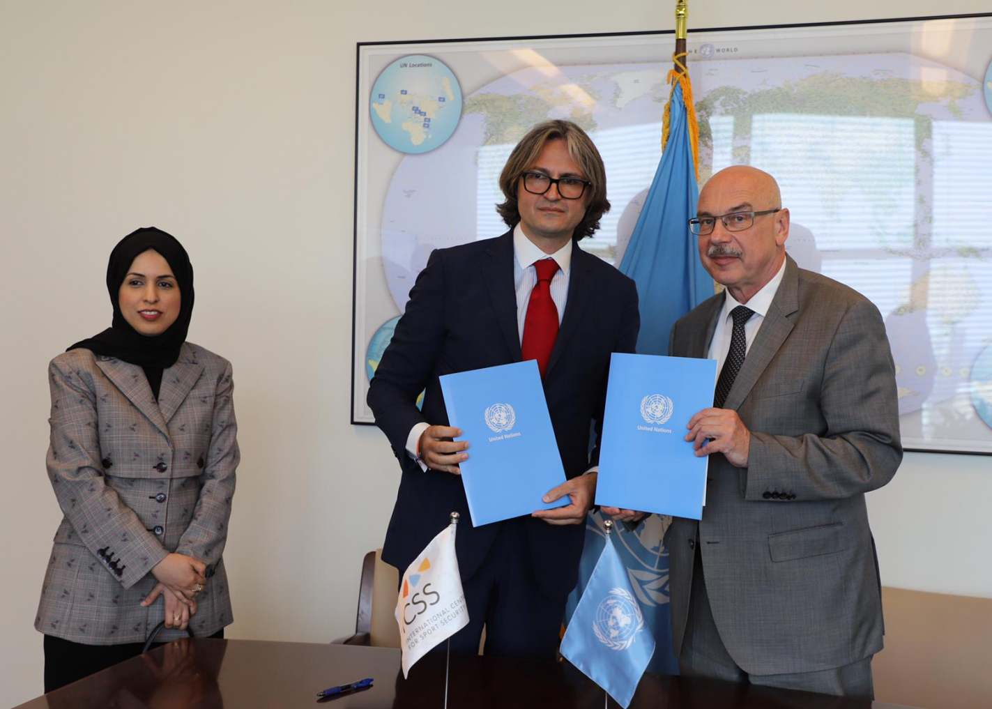 Representatives from UNOCT and ICSS at the signing ceremony