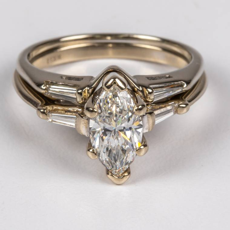 14kt white gold and diamond ring set with one ring having a marquise-cut diamond