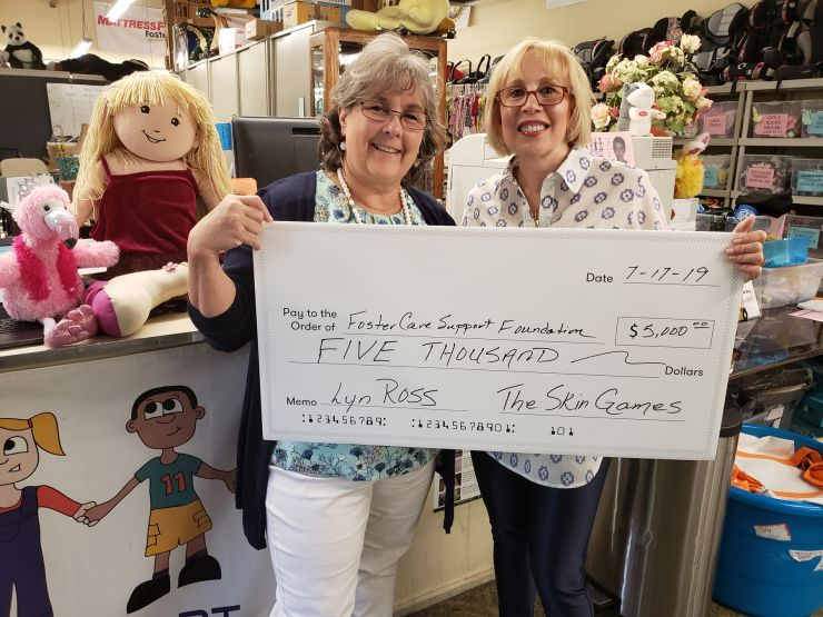 Lyn Ross presents check to Rachel Ewald