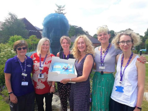 Alison Page presents cake to Hospice of St Francis