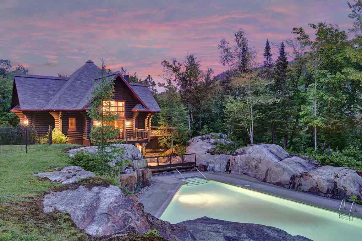 1-16 Chemin du Lac-Cache consists of four authentic log guest cabins.