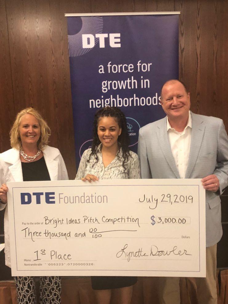 Lynette Dowler, DTE Foundation; winner Tamika Reeves; and Trevor Lauer, DTE