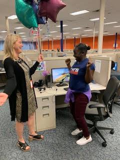 SaviLinx CEO Heather D. Blease notifies Jequetta Dean she's the 2019 SaviScholar