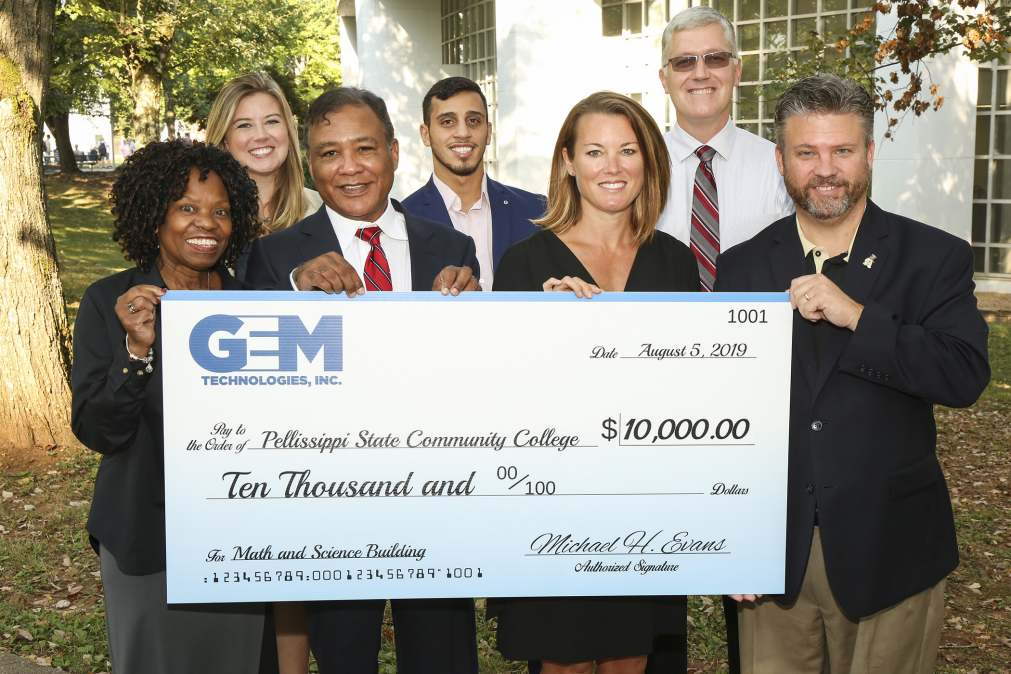 GEM Technologies presents check to Dr. Anthony Wise (far right).