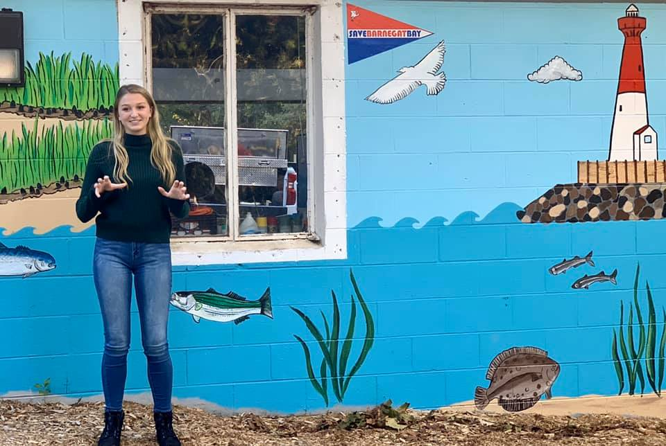 Rory Leadbeater unveils new wall murals at Save Barnegat Bay's EcoCenter.