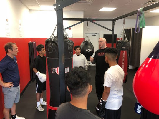 Billy Lyell (left) and Kelly Pavlik (2nd to right) with trainees