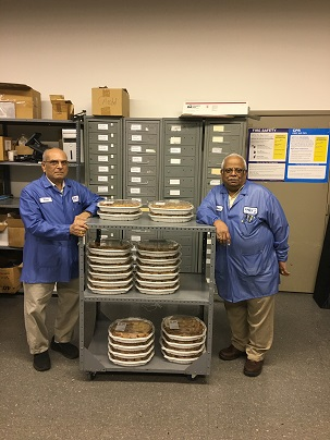 NJMET employees Natu &Harry Patel pose with pies to be donated to Oasis