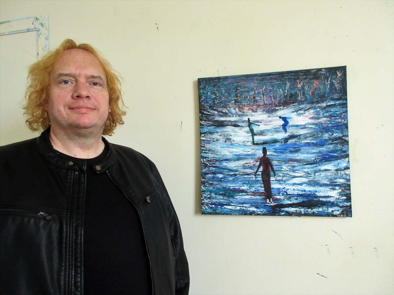 Carl Parker with his painting, Night Rink.