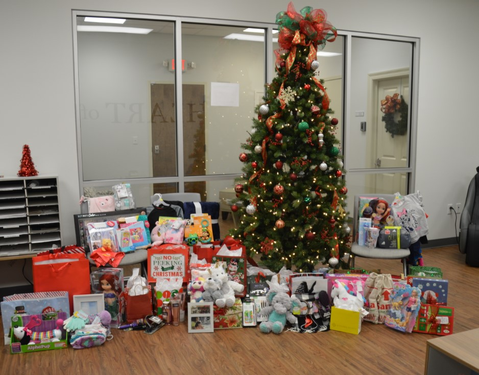 """Picture of donated toys underneath the """"Angel Tree"""""""