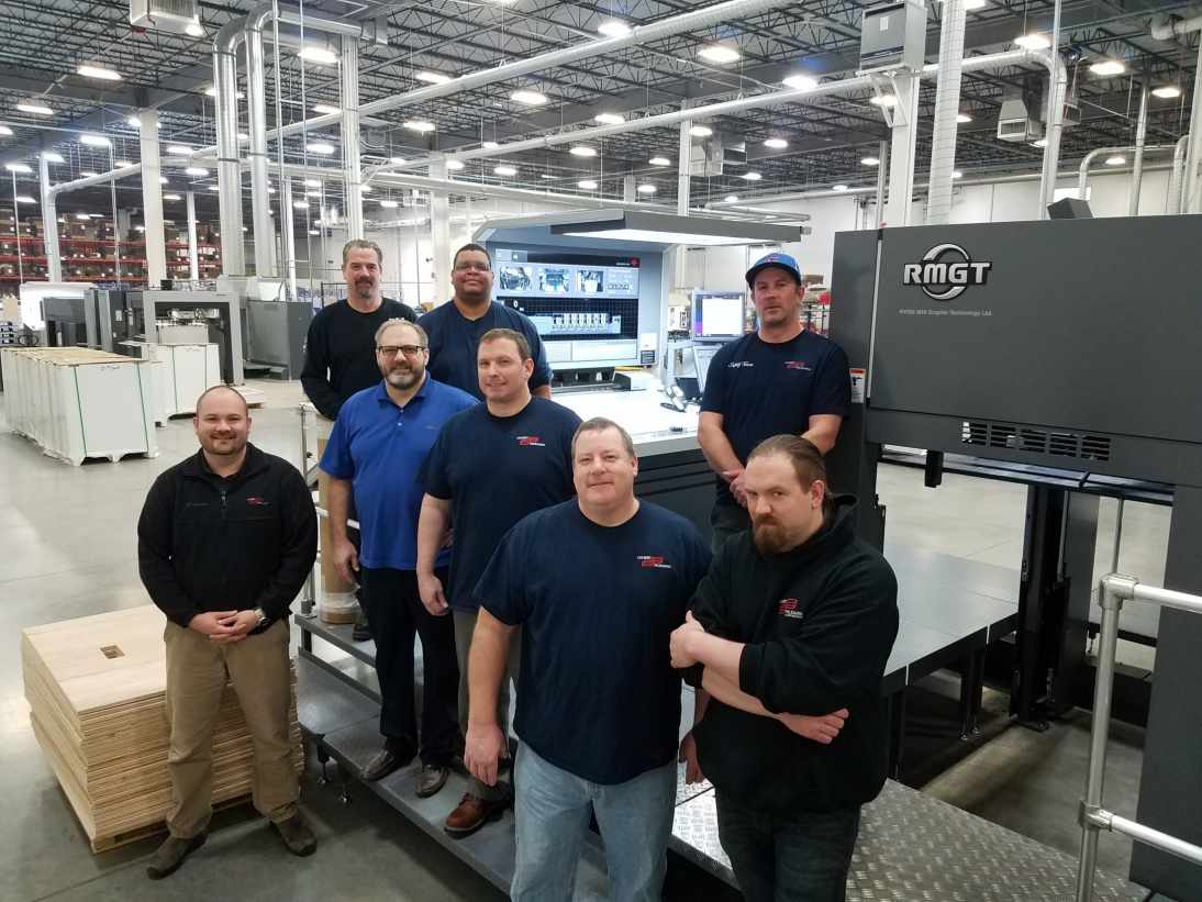 Colbert's Kenosha press operators learn to work with the new RMGT Press.