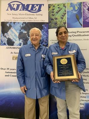 Jim Federico, left, presenting her Service Award plaque to Manisha Patel