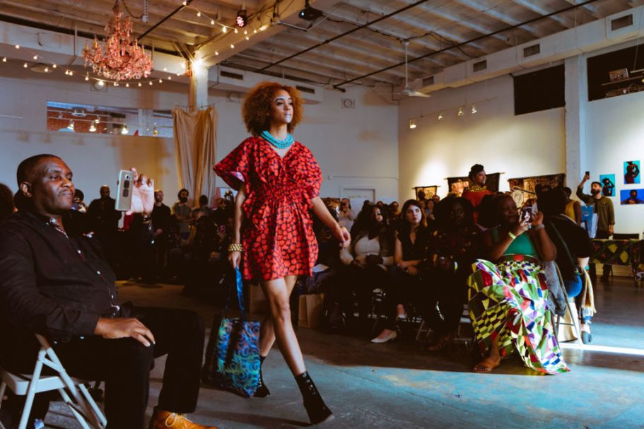 Woman walks the runway at African market festival