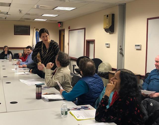 Jamie Zahlaway Belsito greeting members of the Burlington Democratic Committee