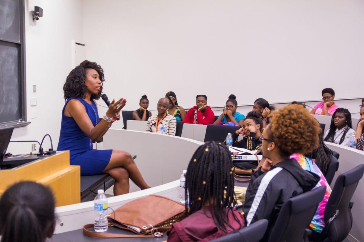 Brandi Harvey speaking to young women.
