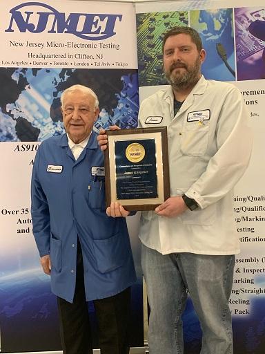 James Klingener, right, receives his plaque from Giacomo Federico