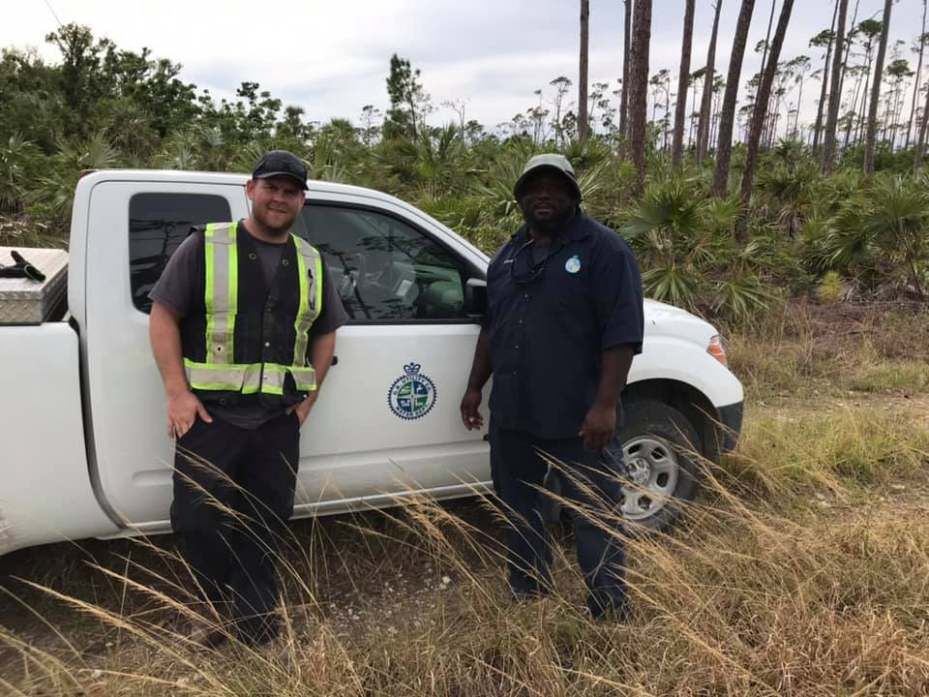 Gavin Waterfield (L) working with Davado (R), a water Operator in the Bahamas