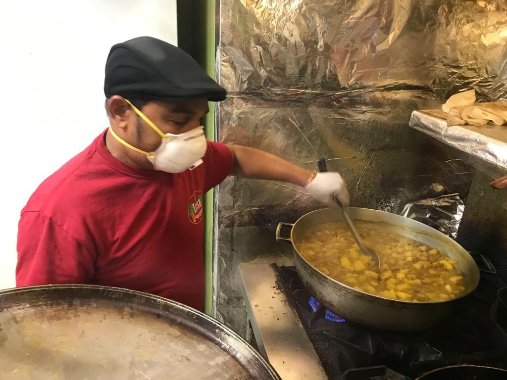 Tassa Roti Staffer Makes Food for Emory Employees