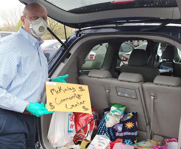 John Opron prepares donation for drop off