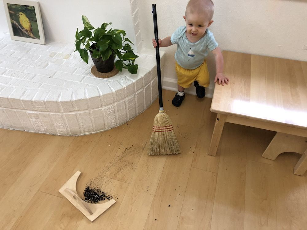 Toddler Sweeping With A Broom Independently