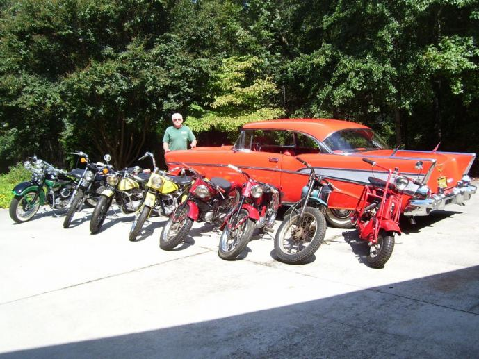 Buddy Austin with vintage cars and motorcycles.
