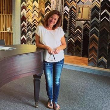 Marna Conner inside Lotus Gallery & Fine Framing.
