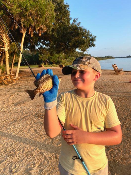 Luke Thomas looking it his Mangrove Snapper catch