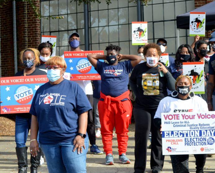 Atlanta GOTV crew distributes yard signs, posters