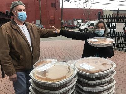 Eva's Kitchen staff with NJMET food donations.