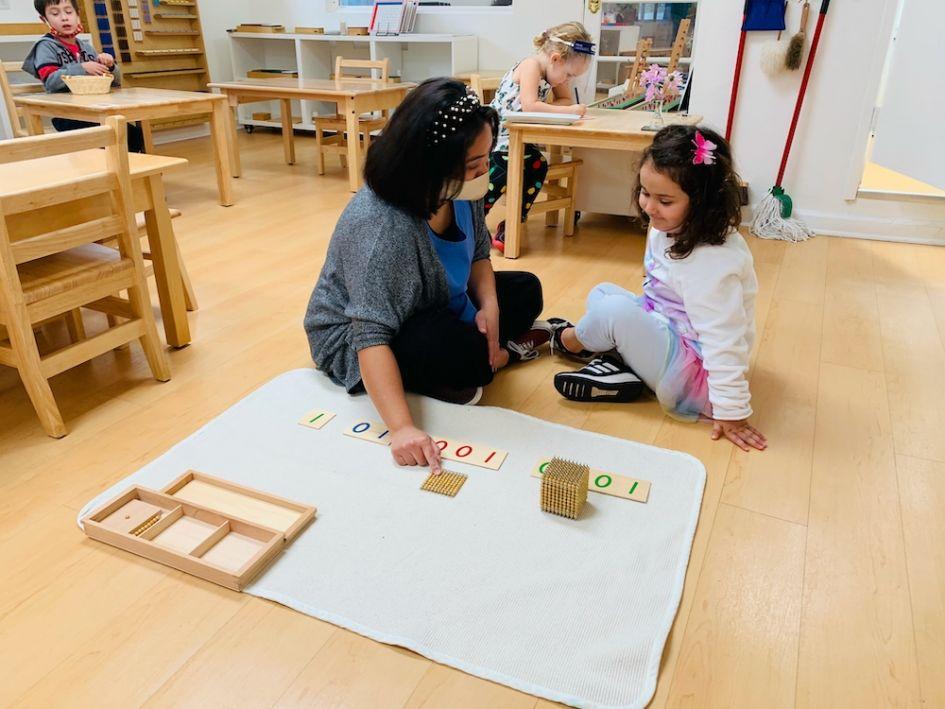 Girl Learning Math With Teacher Guidance At La Jol