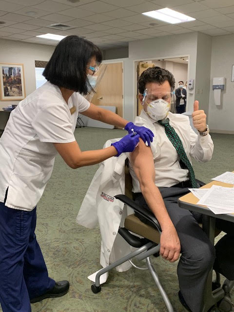 Dr Paul Liguori receiving vaccine