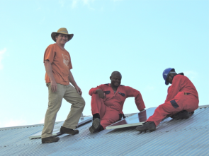 Eric Youngren installing solar system in Tanzania