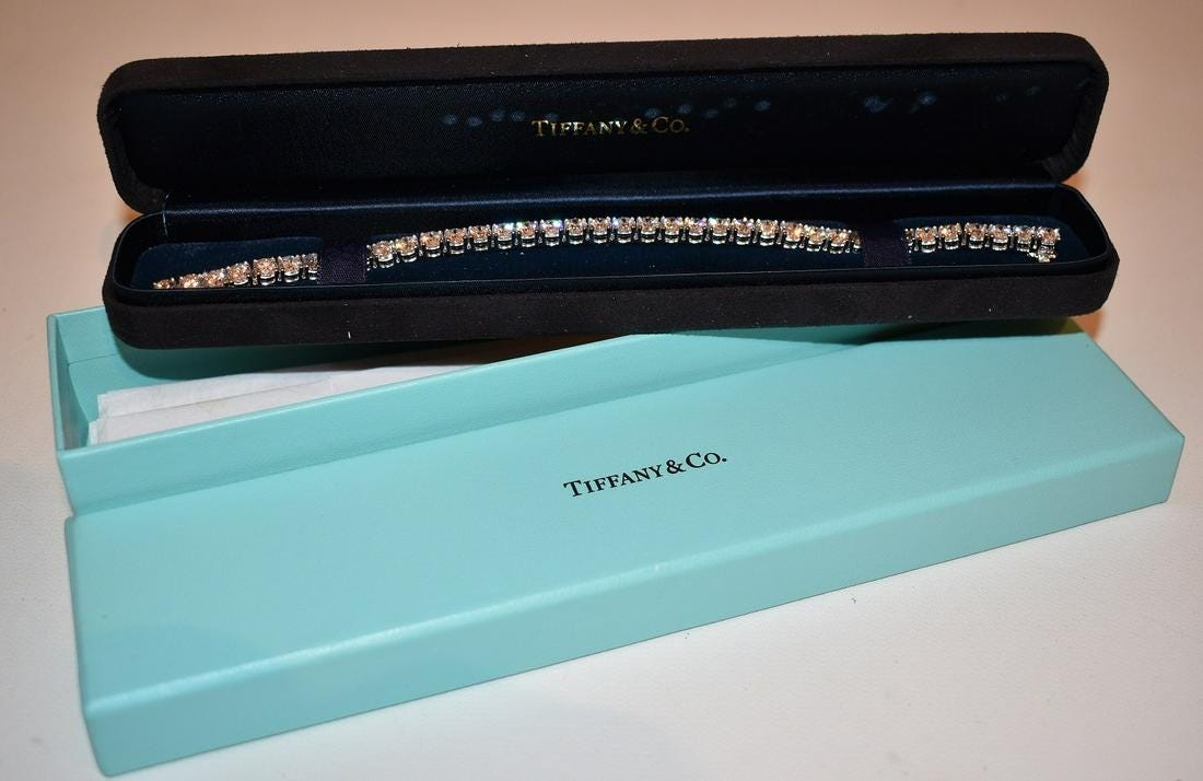 Deco 18kt white gold and diamond tennis bracelet.