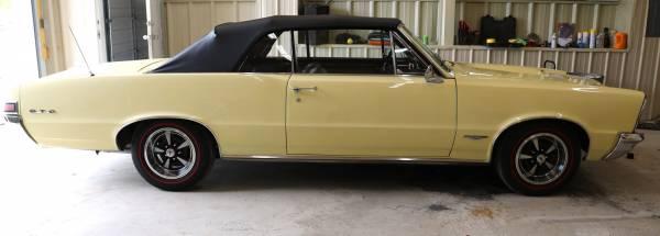 Yellow 1965 Pontiac GTO classic car in great shape