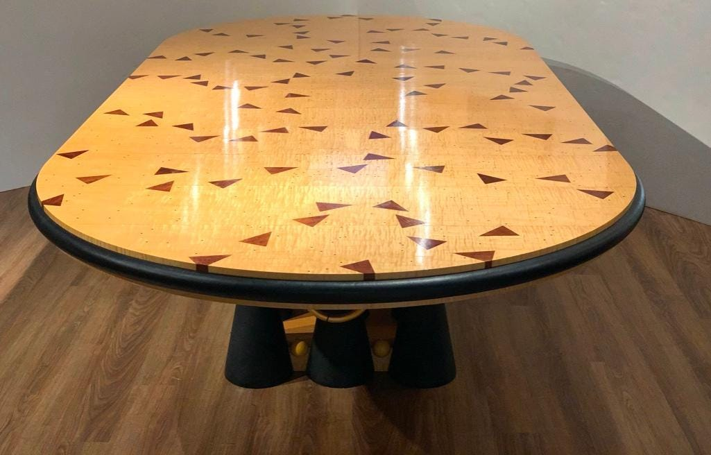 Dining table custom designed by Wendell Castle.