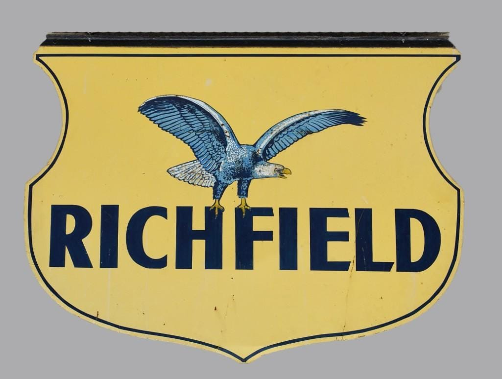 Richfield Oil double-sided sign with eagle mascot.